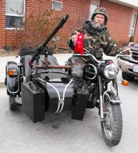 Bob Ward rides his replica World War II motorcycle.