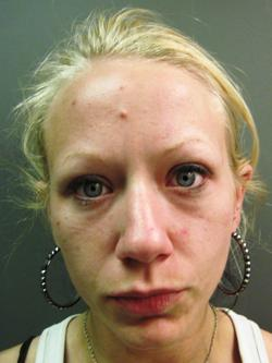 Two arrested on charges of burglary, stealing check from